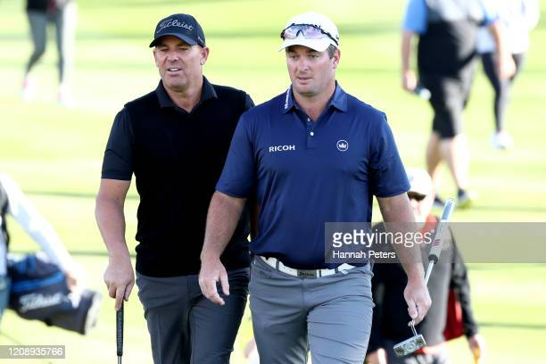 Shane Warne of Australia and Ryan Fox of New Zealand look on during day one of the 2020 New Zealand Golf Open at The Hills on February 27, 2020 in...