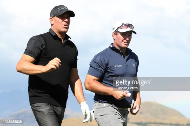 Shane Warne of Australia and Ryan Fox of New Zealand walk on during day one of the 2020 New Zealand Golf Open at The Hills on February 27, 2020 in...