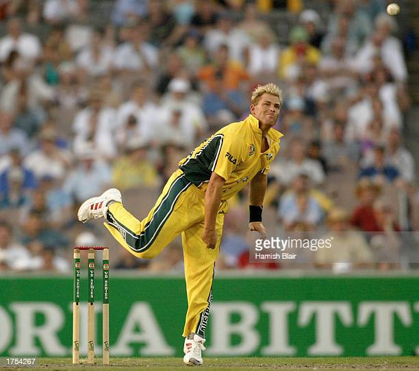 Shane Warne of Australia bowls during the second match in the VB series One Day International finals between Australia and England held at the...