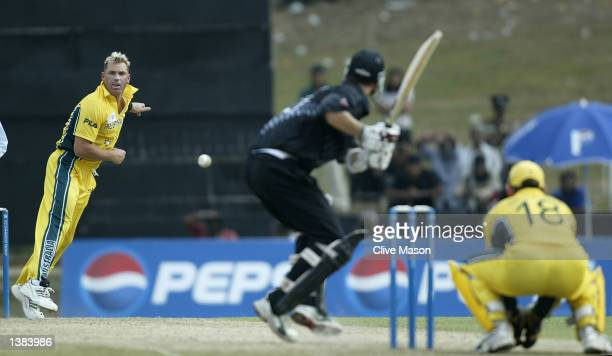 Shane Warne of Australia bowls to dismiss Shane Bond of New Zealand during the ICC Champions Trophy match between Australia and New Zealand at the...