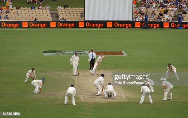 Shane Warne of Australia bowls to England batsman Craig White during the 2nd Test match between Australia and England at the Adelaide Oval Adelaide...
