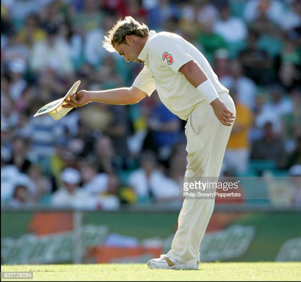 Shane Warne of Australia bows to the crowd after appreciation of the wicket of England's Andrew Flintoff during the 5th Test match between Australia...