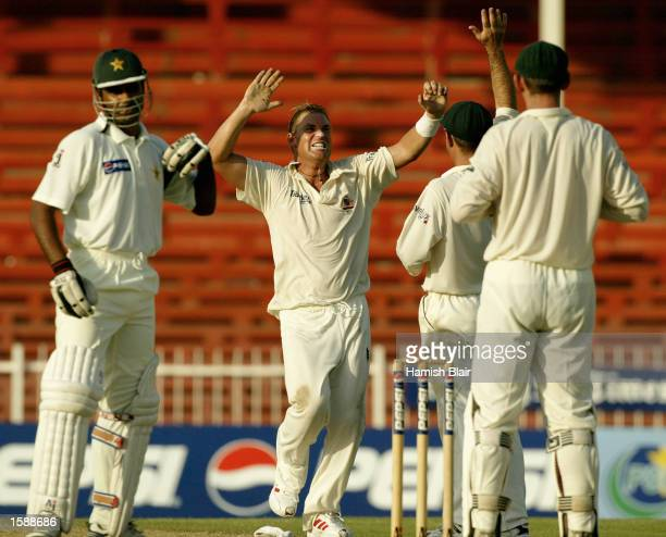 Shane Warne of Australia celebrates after taking the final wicket of the game during day two of the Second Test match between Pakistan and Australia...