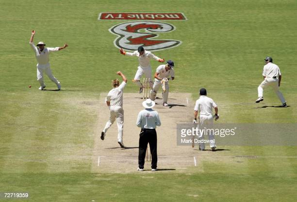 Shane Warne of Australia celebrates dismissing Kevin Pietersen of England during day five of the second Ashes Test Match between Australia and...