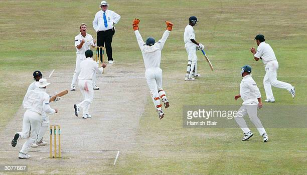 Shane Warne of Australia celebrates his 500th career wicket after dismissing Hashan Tillakaratne of Sri Lanka during day five of the First Test...