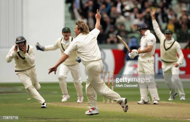 Shane Warne of Australia celebrates taking his 700th wicket during day one of the fourth Ashes Test Match between Australia and England at the...