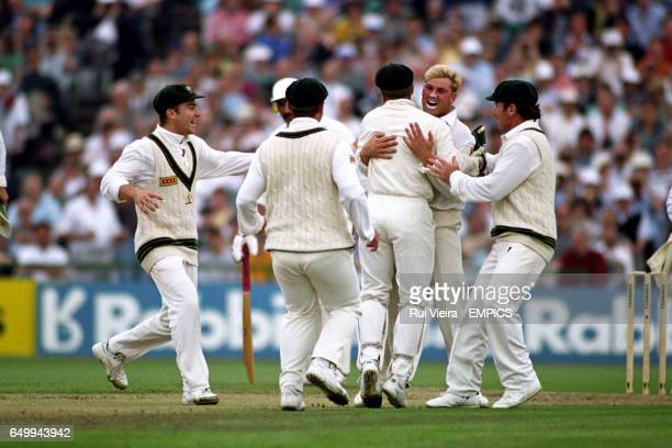 Shane Warne of Australia celebrates taking the wicket of Mike Gatting with his first ball of the innings