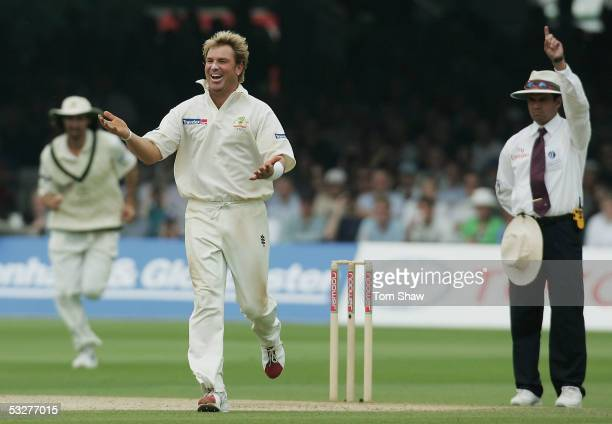 Shane Warne of Australia celebrates the wicket of Andrew Flintoff of England during day three of the first npower Ashes Test match between England...