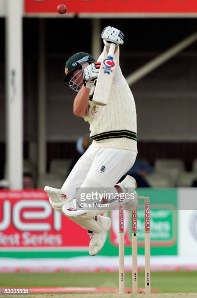 Shane Warne of Australia faces a bouncer off the bowling of Steve Harmison during day four of the second npower Ashes Test match between England and...