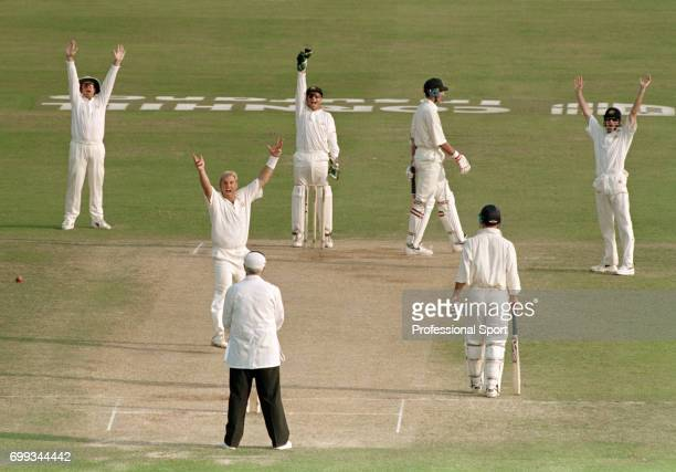 Shane Warne of Australia gets the wicket of England batsman Ben Hollioake for 2 runs during the 5th Test match between England and Australia at Trent...