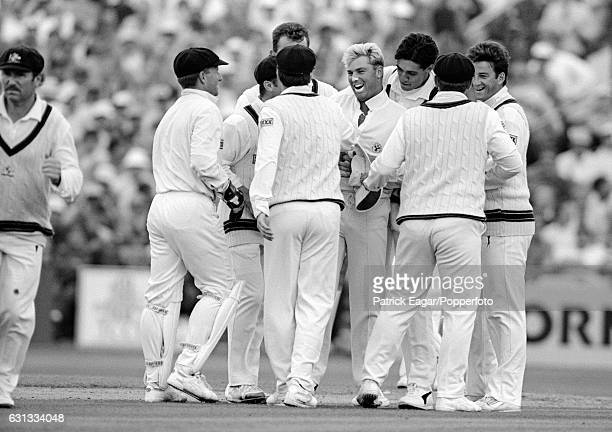Shane Warne of Australia is congratulated by teammates after bowling England batsman Mike Gatting with his first delivery in the 1st Test match...