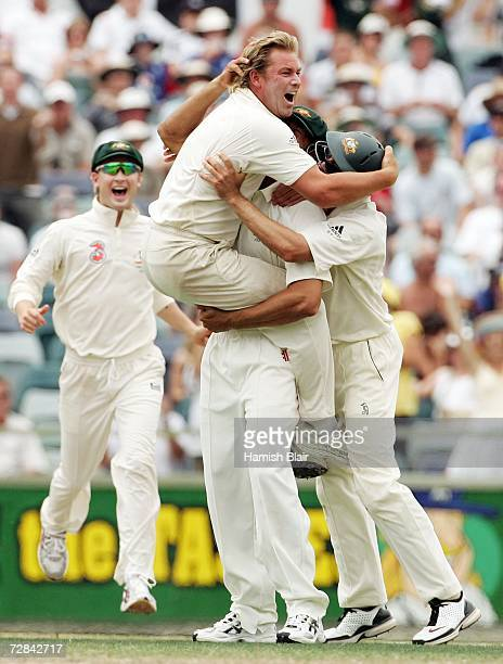 Shane Warne of Australia is congratulated by teammates after dismissing Monty Panesar of England during day five of the third Ashes Test Match...
