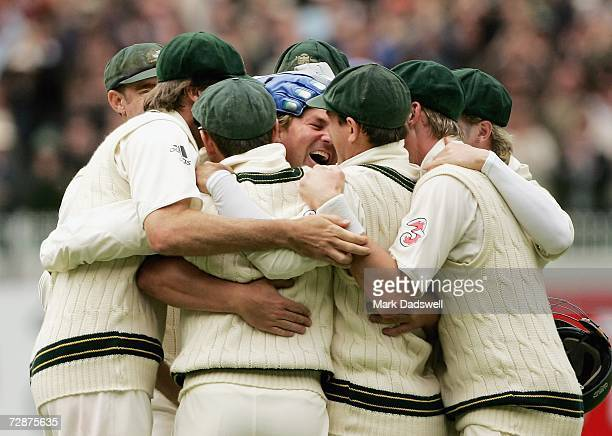 Shane Warne of Australia is congratulated by teammates after taking his 700th wicket during day one of the fourth Ashes Test Match between Australia...