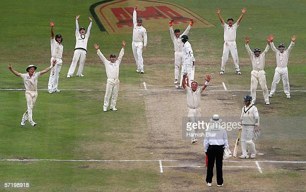 Shane Warne of Australia leads his team mates in a successful appeal for the final wicket of Makhaya Ntini of South Africa during day five of the...