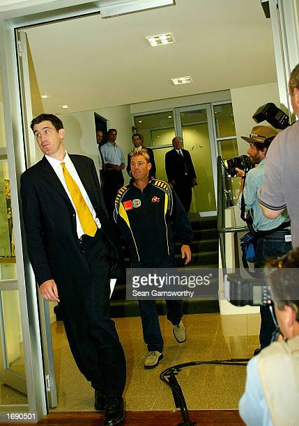 Shane Warne of Australia leaves the press conference where he spoke with the media regarding his shoulder injury at the Australian Cricket Board...