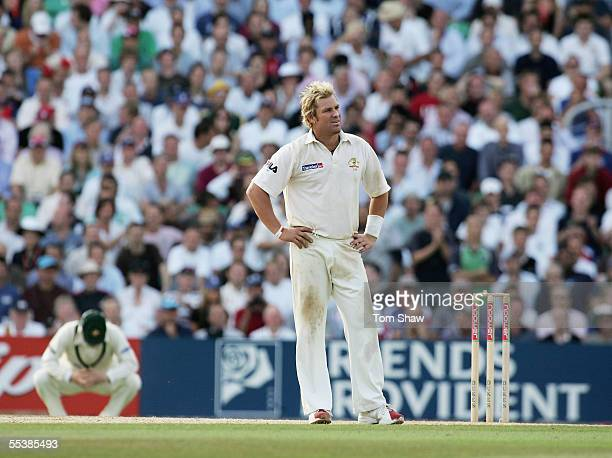 Shane Warne of Australia looks dejected during day five of the Fifth npower Ashes Test match between England and Australia at the Brit Oval on...