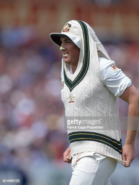 Shane Warne of Australia pulls his jumper on during the 4th Test match between England and Australia at Headingley Leeds 24th July 1993