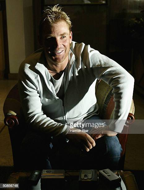 Shane Warne of Australia speaks to the media at the Crowne Plaza Hotel on May 19 2004 in Harare Zimbabwe