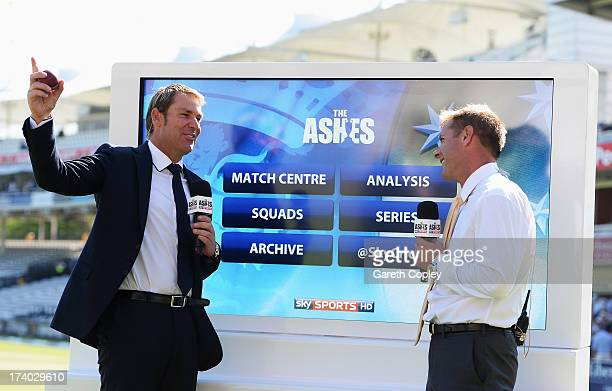 Shane Warne of Australia talks to Ian Ward at the Sky Sports analysis board during day two of the 2nd Investec Ashes Test match between England and...