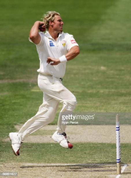Shane Warne of the Bushrangers bowls during day three of the Pura Cup match between the Victorian Bushrangers and the Tasmanian Tigers at the...