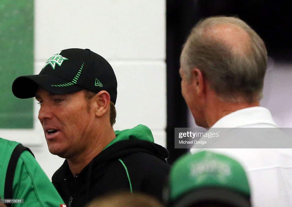 Shane Warne of the Melbourne Stars celebrates their win with his dad Keith Warne in the club rooms after the Big Bash League match between the Melbourne Stars and the Sydney Thunder at Melbourne Cricket Ground on January 8, 2013 in Melbourne, Australia.