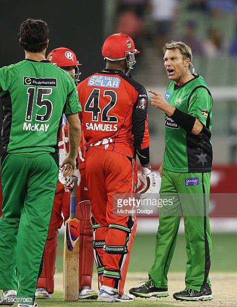 Shane Warne of the Melbourne Stars has a heated exchange with Marlon Samuels of the Melbourne Renegades during the Big Bash League match between the...