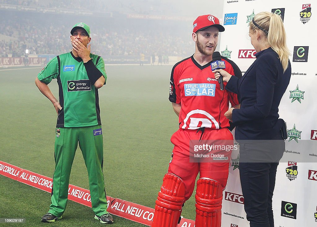 Shane Warne (l) of the Melbourne Stars waits for his interview after losing the Big Bash League match between the Melbourne Stars and the Melbourne Renegades at Melbourne Cricket Ground on January 6, 2013 in Melbourne, Australia.