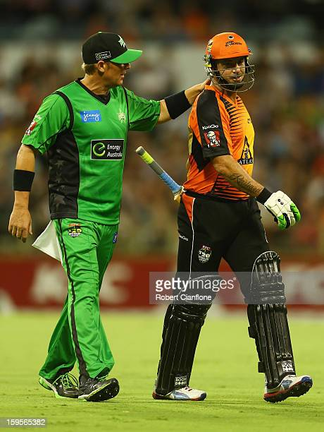 Shane Warne of the Stars acknowedges Herschelle Gibbs of the Perth Scorchers as he leaves the ground with an injury during the Big Bash League...