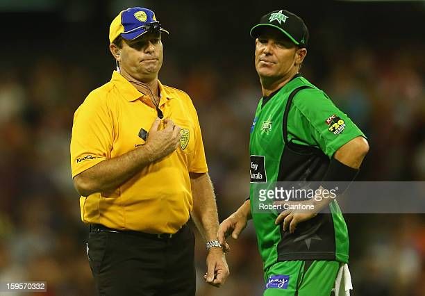 Shane Warne of the Stars has words with the umpire after James Faulkenr bowled a noball of the last ball during the Big Bash League semifinal match...