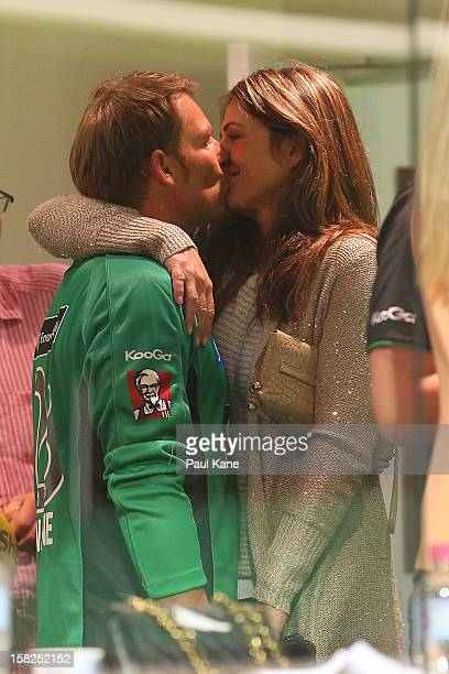 Shane Warne of the Stars kisses Liz Hurley in the players rooms after winning the Big Bash League match between the Perth Scorchers and the Melbourne...