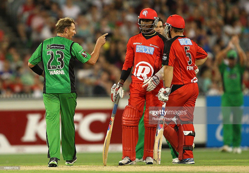 Shane Warne of the Stars points his finger towards Marlon Samuels of the Stars during the Big Bash League match between the Melbourne Stars and the Melbourne Renegades at Melbourne Cricket Ground on January 6, 2013 in Melbourne, Australia.