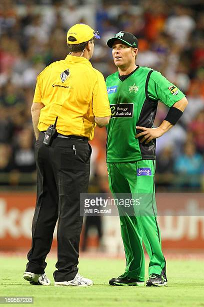 Shane Warne of the Stars talks to the referee after a free hit is given during the Big Bash League semifinal match between the Perth Scorchers and...