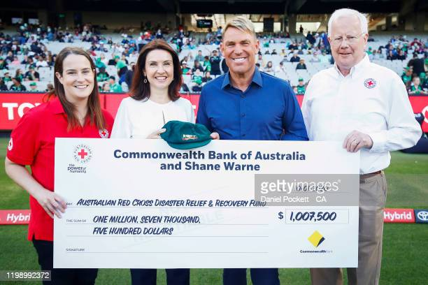 Shane Warne poses for a photograph with his baggy green cap, along with Red Cross and Commonwealth Bank representatives, ahead of the Big Bash League...