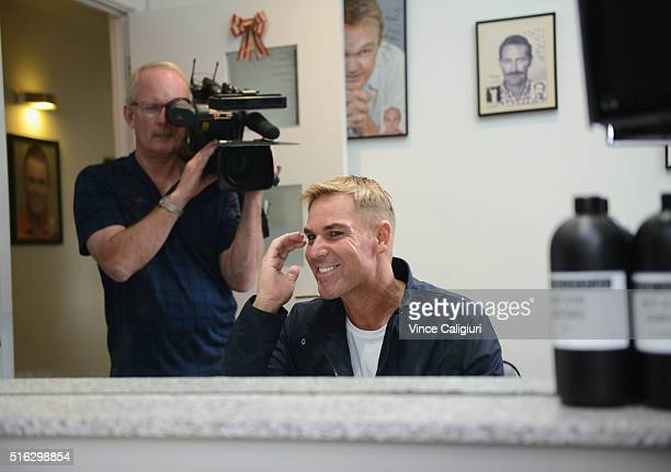 Shane Warne poses with his new hair look during a media opportunity at Advanced Hair Studio on March 18 2016 in Melbourne Australia Shane Warne was...