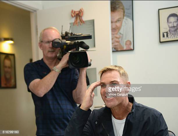 Shane Warne poses with his new hair look during a media opportunity at Advanced Hair Studio on March 18, 2016 in Melbourne, Australia. Shane Warne...
