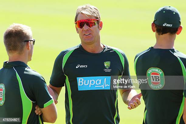 Shane Warne speaks to players during an Australian nets session at Newlands Stadium on February 27 2014 in Cape Town South Africa