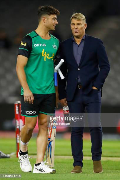 Shane Warne speaks with Marcus Stoinis of the Stars ahead of the Big Bash League match between the Melbourne Renegades and the Melbourne Stars at...