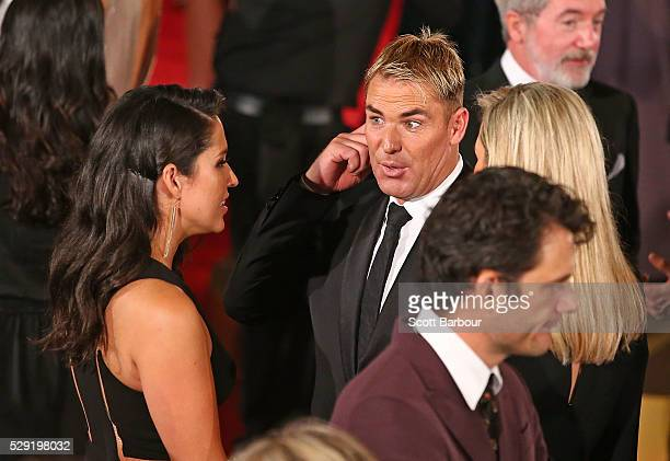 Shane Warne talks to Mel McLaughlin as they arrive at the 58th Annual Logie Awards at Crown Palladium on May 8, 2016 in Melbourne, Australia.