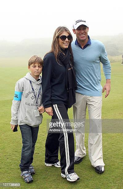 Shane Warne with Elizabeth Hurley and her son Damian during the third round of The Alfred Dunhill Links Championship at the Kingsbarns Golf Links on...
