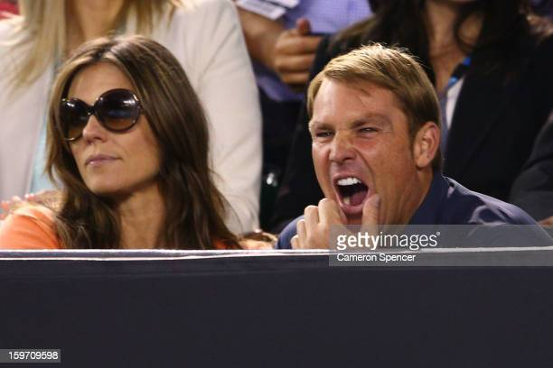 Shane Warne yawns at the men's third round match between Roger Federer of Switzerland and Bernard Tomic of Australia during day six of the 2013...