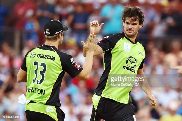 Shane Watson and Clint McKay of the Sydney Thunder celebrate the wicket of Travis Head of the Adelaide Strikers during the Big Bash League Semi Final...