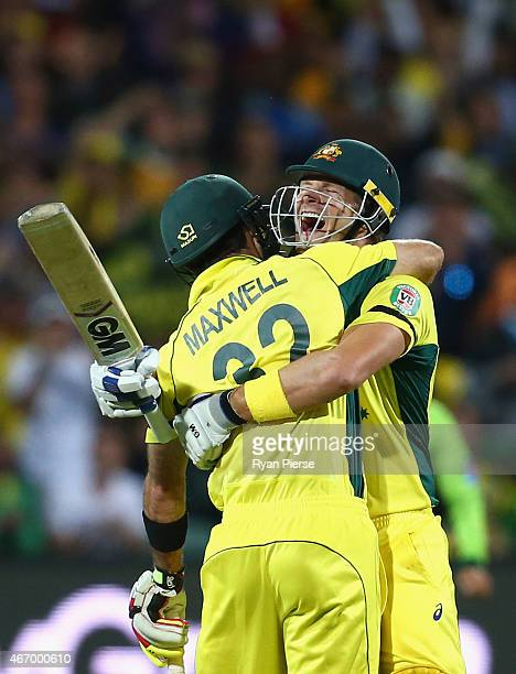 Shane Watson and Glenn Maxwell of Australia celebrate victory during the 2015 ICC Cricket World Cup match between Australian and Pakistan at Adelaide...