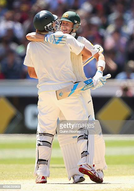 Shane Watson and Michael Clarke of Australia celebrate winning during day four of the Fourth Ashes Test Match between Australia and England at...