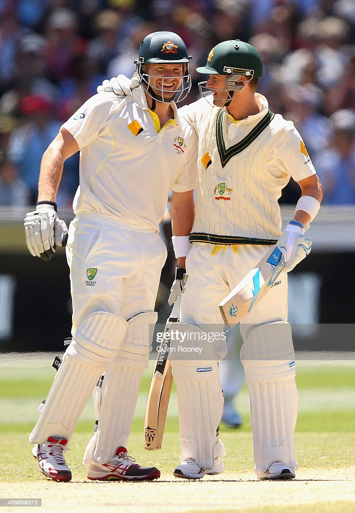Shane Watson and Michael Clarke of Australia celebrate winning during day four of the Fourth Ashes Test Match between Australia and England at Melbourne Cricket Ground on December 29, 2013 in Melbourne, Australia.