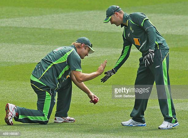 Shane Watson and Michael Clarke of Australia high five during an Australian nets session at the Melbourne Cricket Ground on December 24, 2013 in...