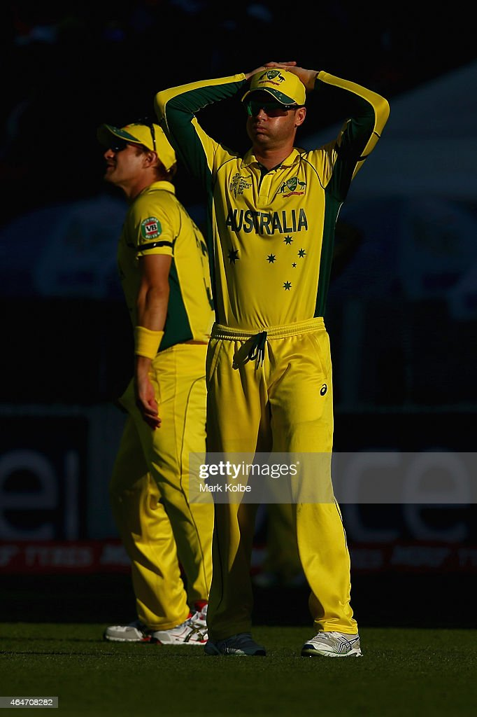 Shane Watson and Michael Clarke of Australia looks dejected during the 2015 ICC Cricket World Cup match between Australia and New Zealand at Eden Park on February 28, 2015 in Auckland, New Zealand.