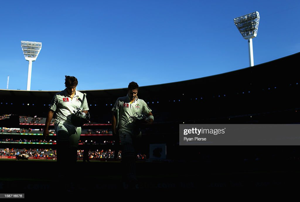 Shane Watson and Michael Clarke of Australia walk from the field at the end of day one of the Second Test match between Australia and Sri Lanka at the Melbourne Cricket Ground on December 26, 2012 in Melbourne, Australia.