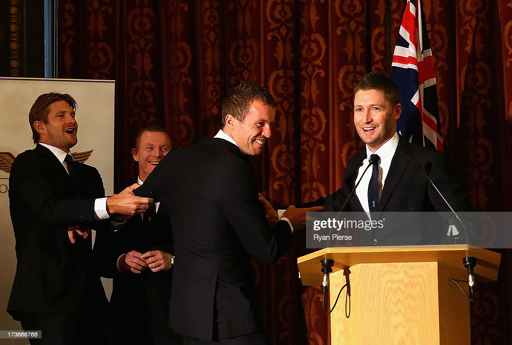 Shane Watson (L) and Michael Clarke (R) pull Peter Siddle (C) away from the microphone during the Australian Cricket Team visit to the Australian High Commision on July 16, 2013 in London, England.