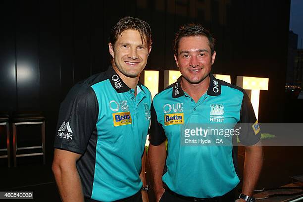 Shane Watson and Peter Forrest pose during the Brisbane Heat Big Bash League season launch at Southbank on December 16 2014 in Brisbane Australia
