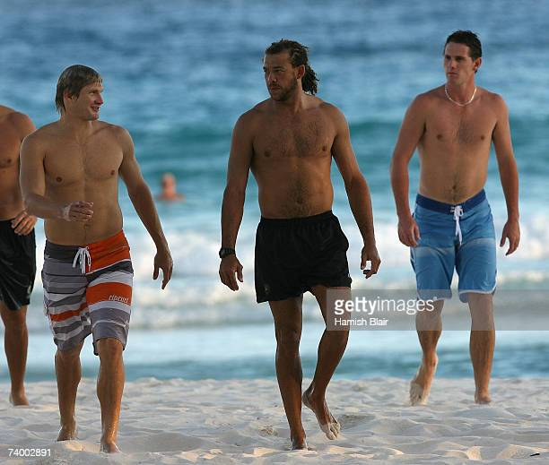 Shane Watson Andrew Symonds and Shaun Tait of Australia walk out of the sea outside the Hilton Hotel on April 27 in Bridgetown Barbados Australia...